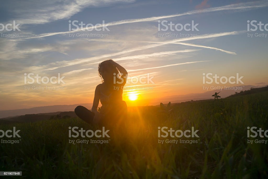 Woman Silhouette in the field stock photo