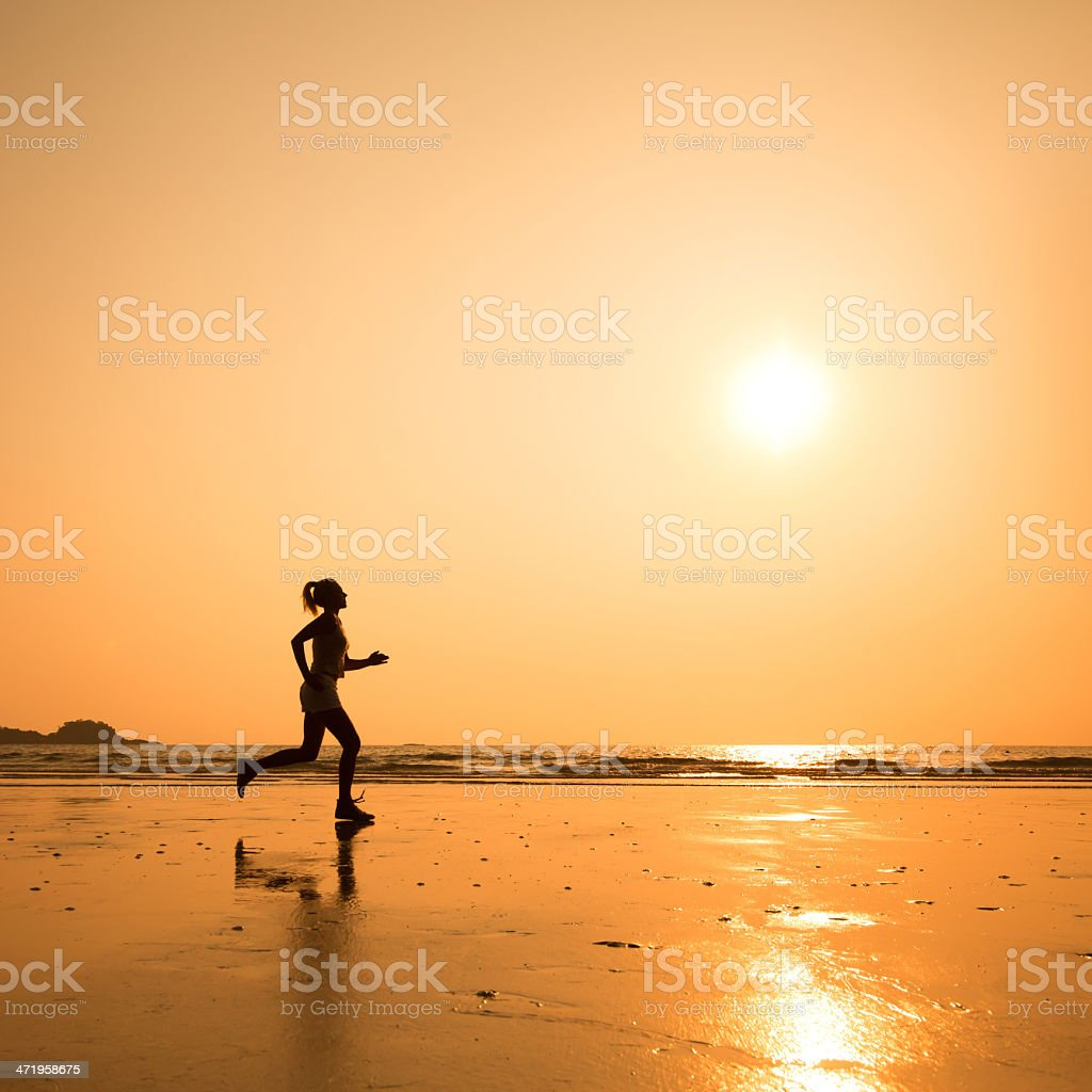 woman silhouette on the beach stock photo