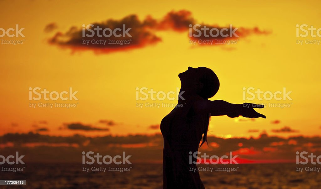 Woman silhouette over sunset royalty-free stock photo