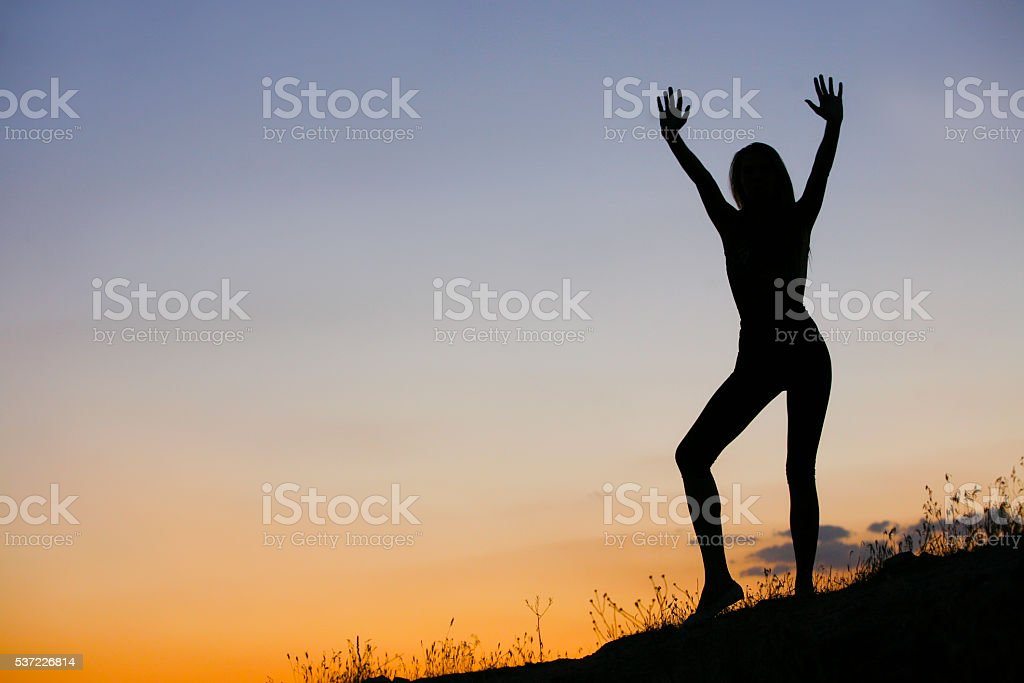 Woman silhouette sunset stock photo