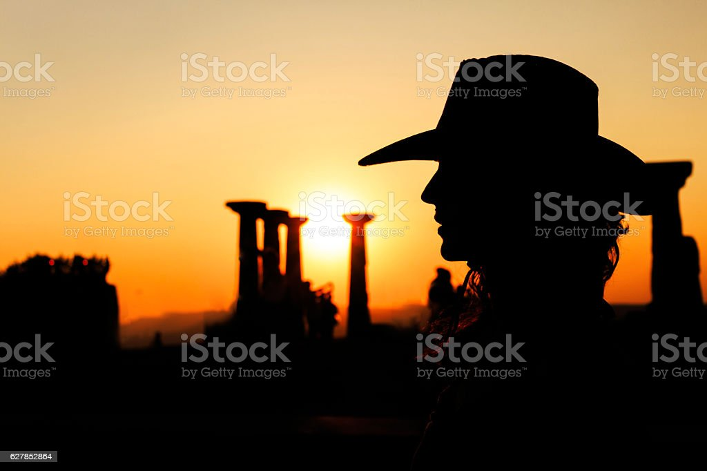 Woman Silhouette with Cowboy Hat stock photo