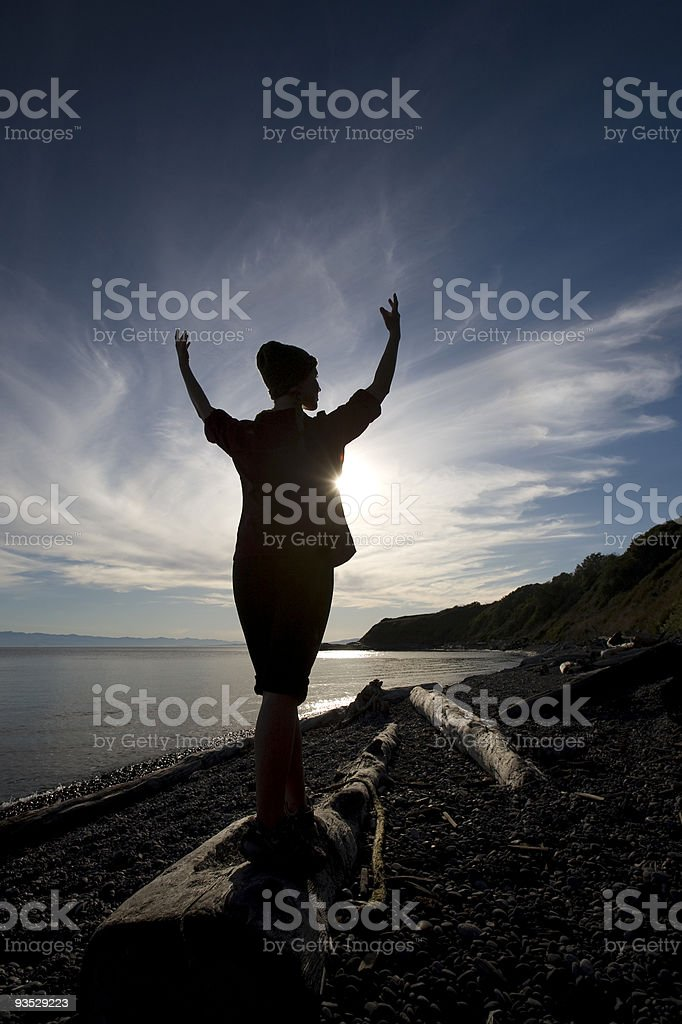 Woman Silhouetted on a Beach royalty-free stock photo