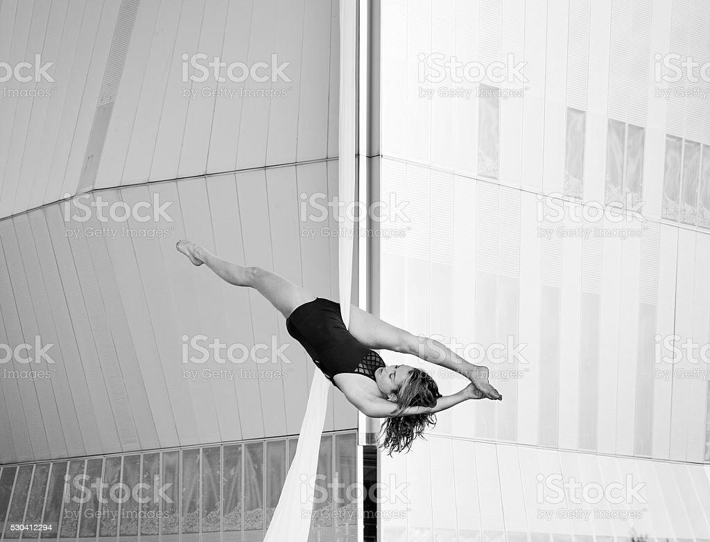 Woman silk aerial dancer stock photo
