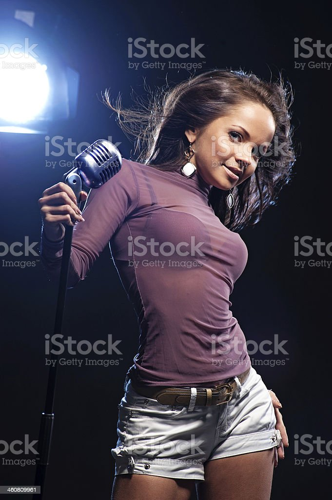 Woman singer in black background stock photo