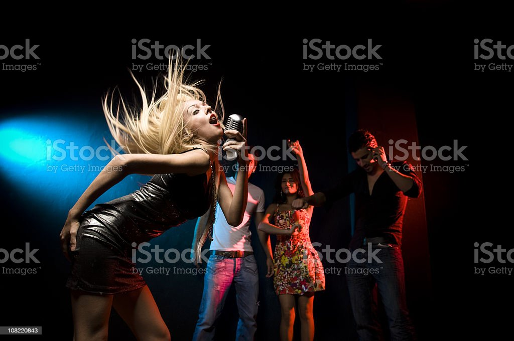 Woman Singing at Club in Front of Crowd royalty-free stock photo