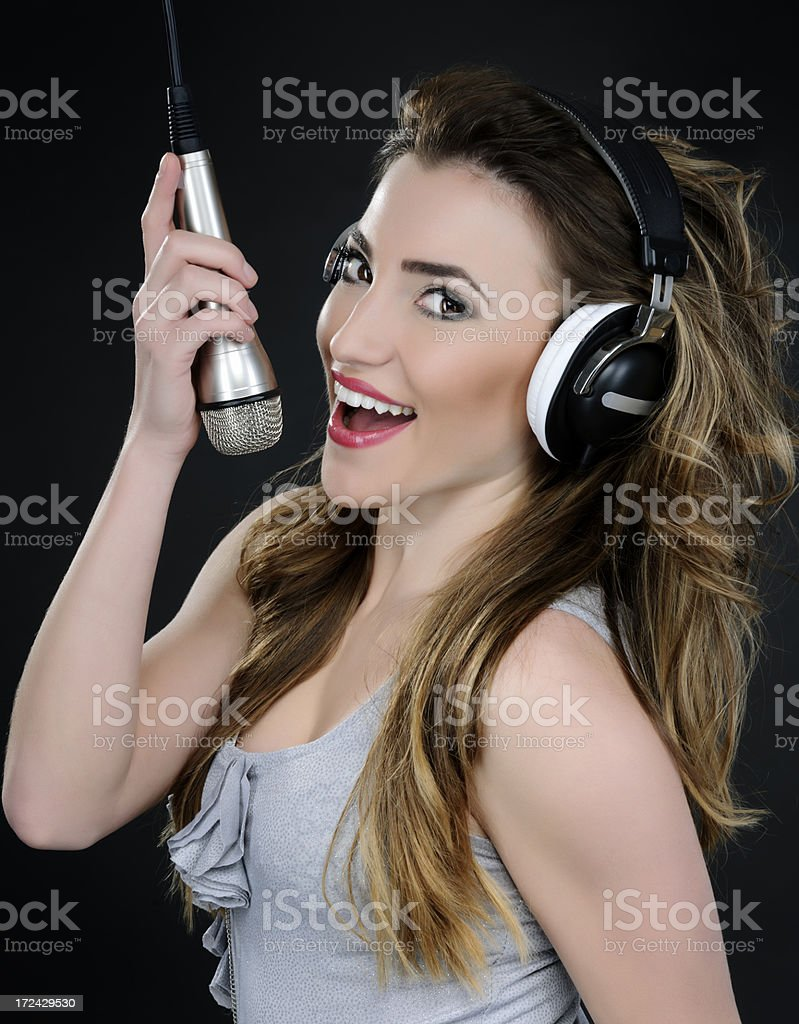 woman singing at microphone royalty-free stock photo
