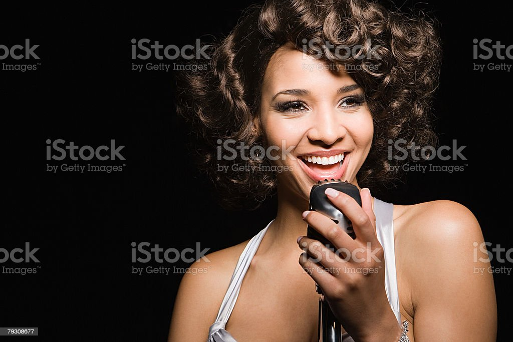 A woman singing stock photo