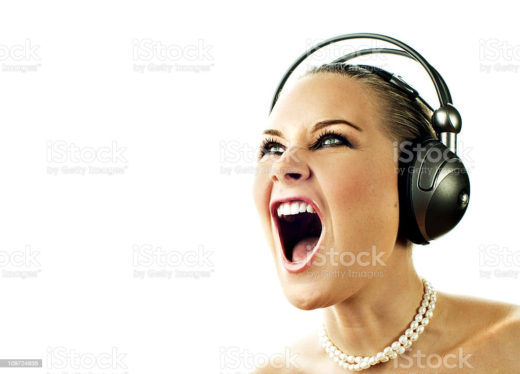 Woman singing with headphones royalty-free stock photo
