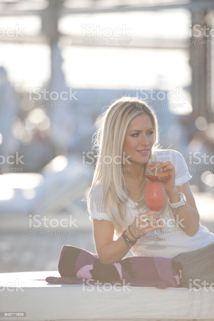 Woman sipping cocktail stock photo
