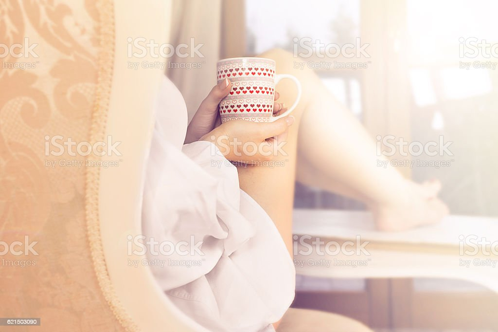 woman sipping coffee in a magic moment of quiet stock photo