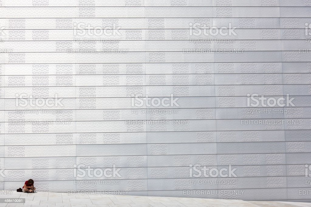 Woman sits at Opera House in Oslo, Norway royalty-free stock photo