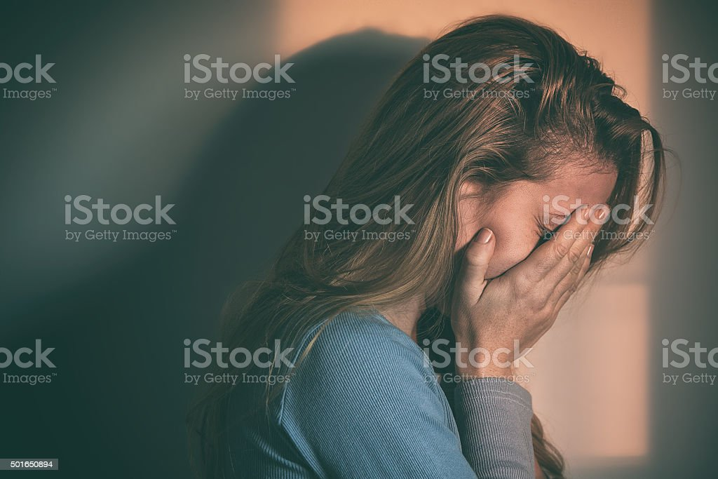 Woman sitting alone and depressed stock photo