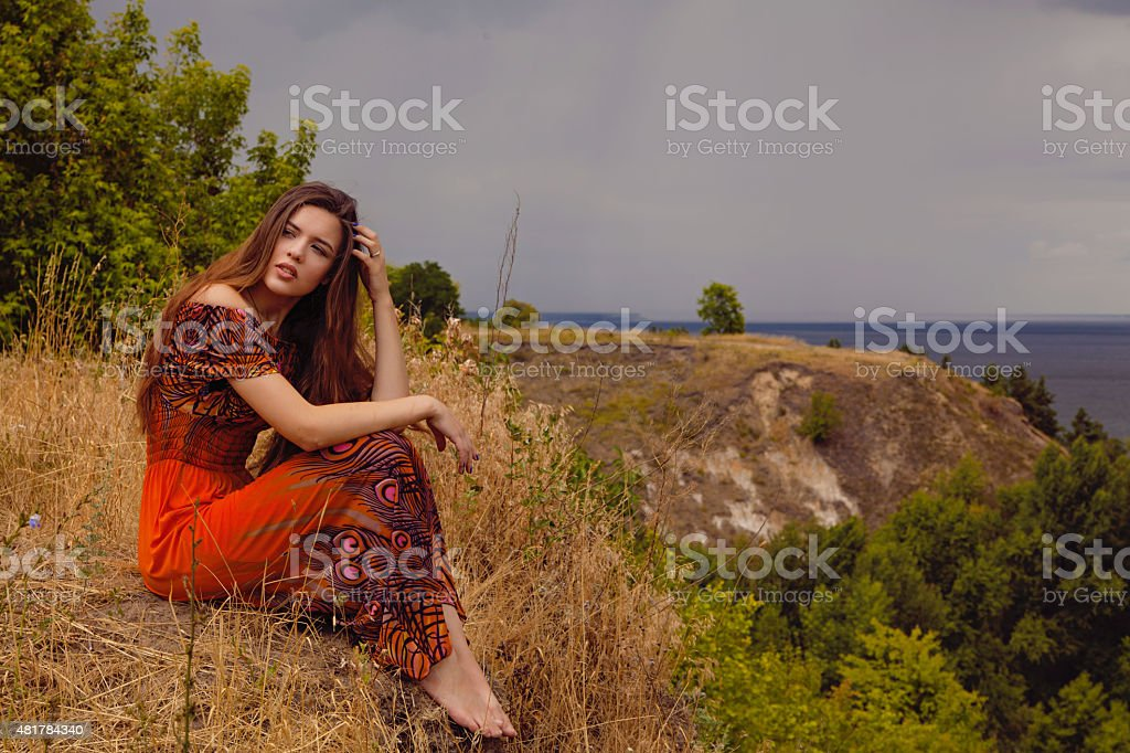 woman sitting alone near the sea royalty-free stock photo