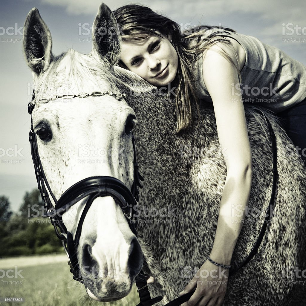 Woman Sitting and Hugging Horse royalty-free stock photo