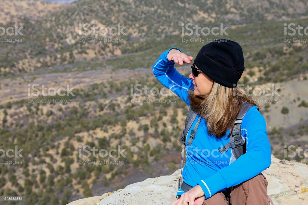 Woman Sitting and Searching the Valley stock photo