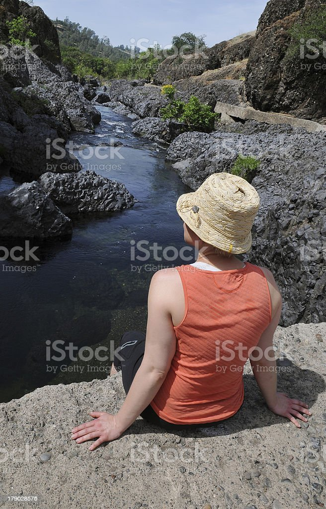 Woman Sitting at a River royalty-free stock photo