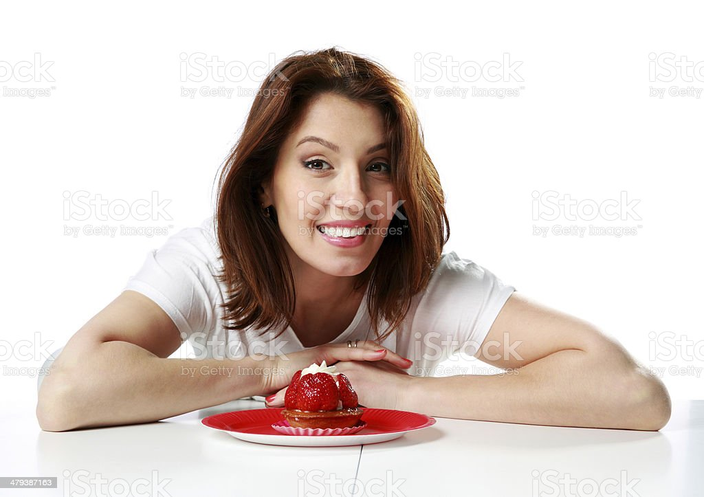 woman sitting at the table with fresh strawberry cake royalty-free stock photo