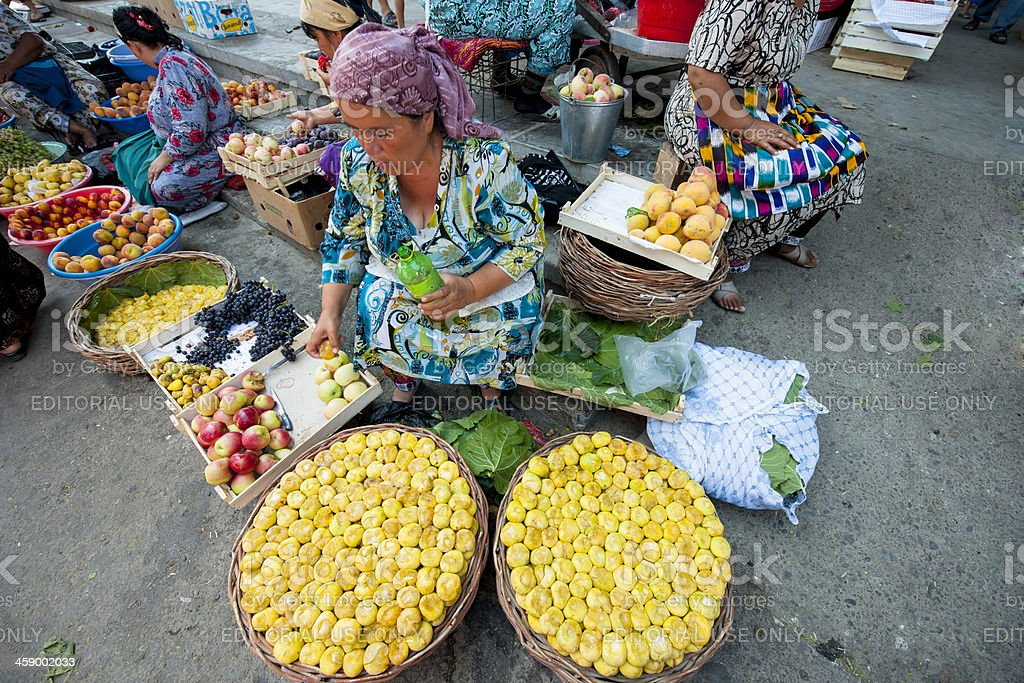 woman sitting behind her fruit stand stock photo