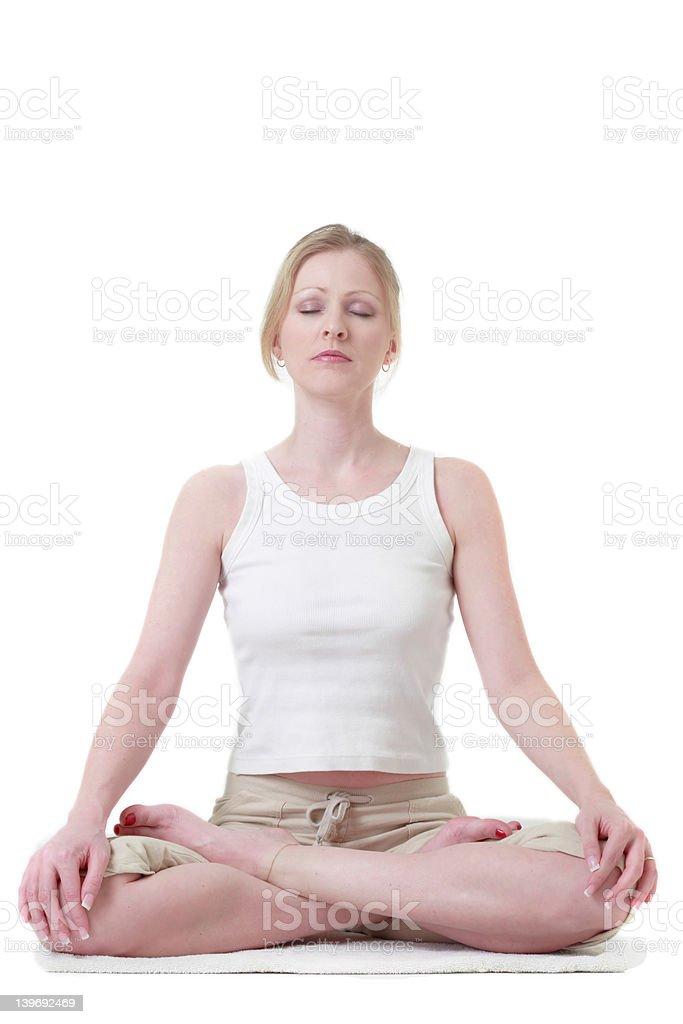 Woman sitting crossed legged stock photo