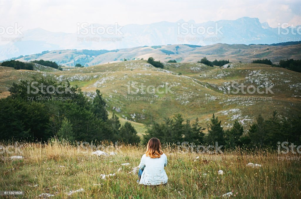 Woman sitting Durmitor National Park stock photo