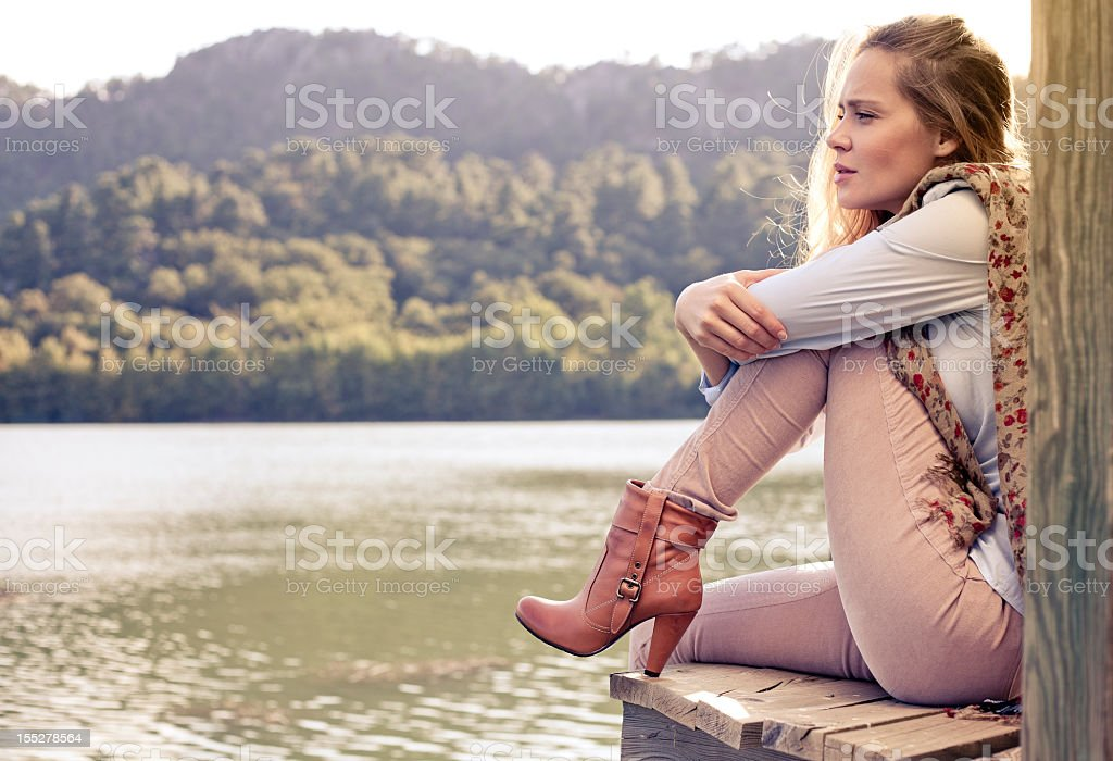 Woman sitting edge of the jetty royalty-free stock photo