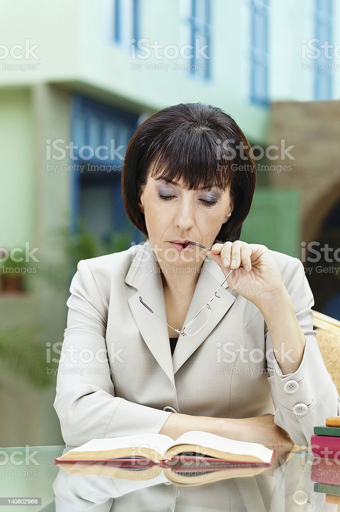 woman sitting glasses book royalty-free stock photo