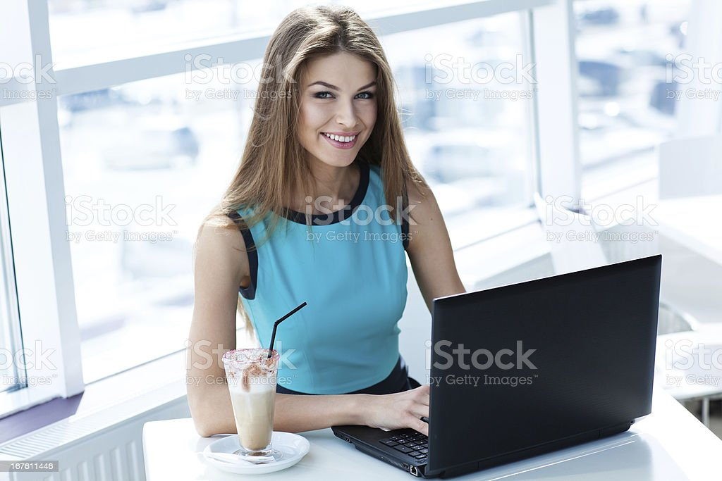 woman sitting in a cafe with laptop royalty-free stock photo