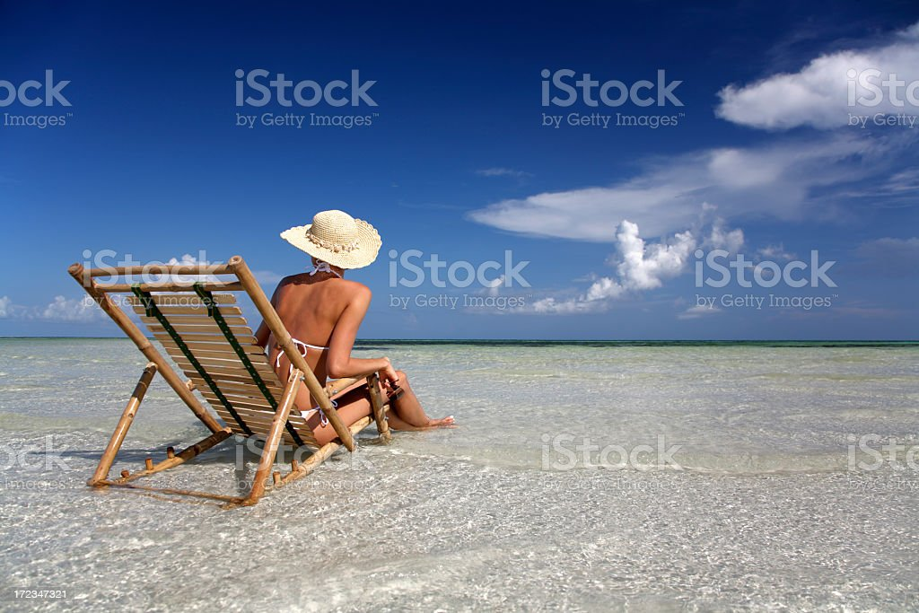 woman sitting in bamboo chair royalty-free stock photo