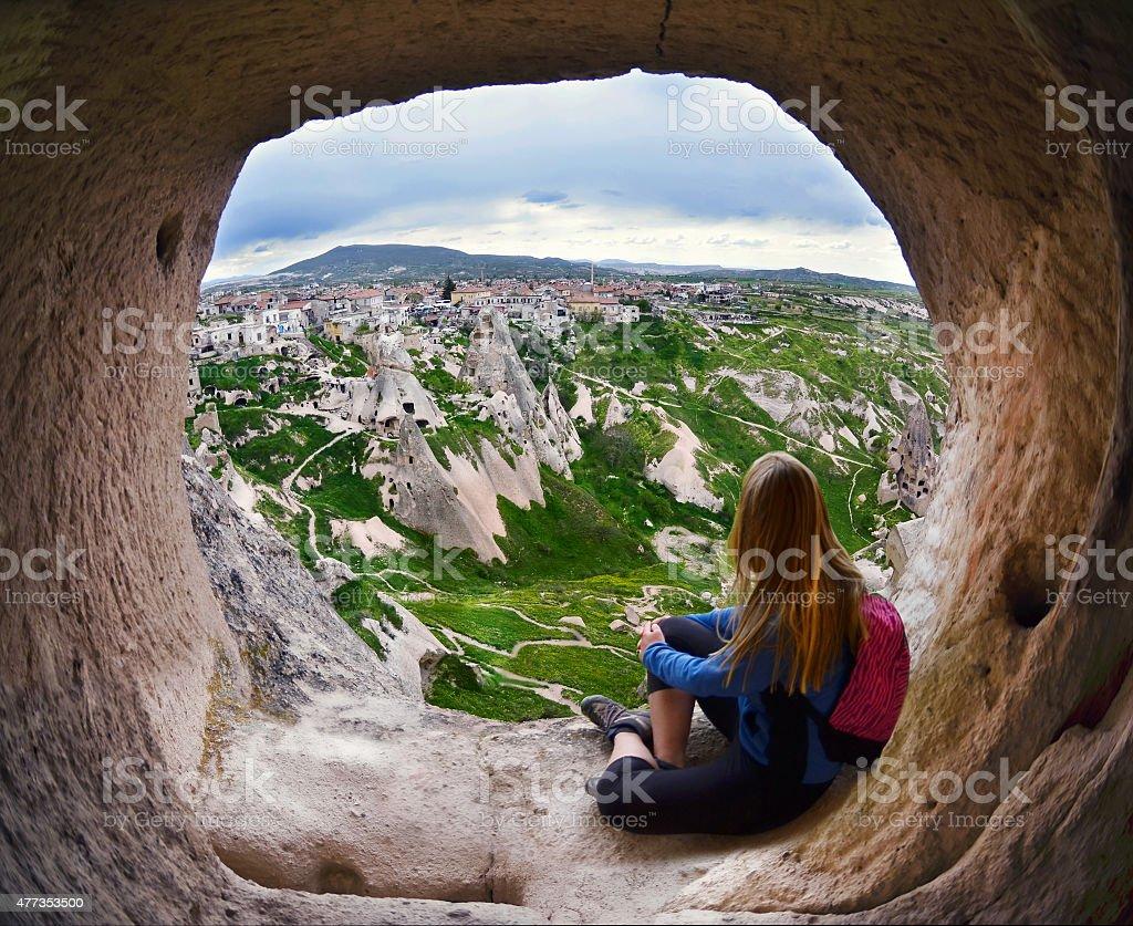 Woman sitting in Cappadocia valley of Turkey stock photo