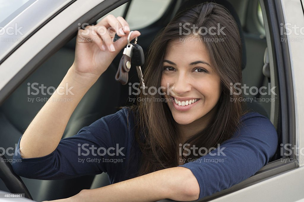 Woman Sitting In Car With Key stock photo