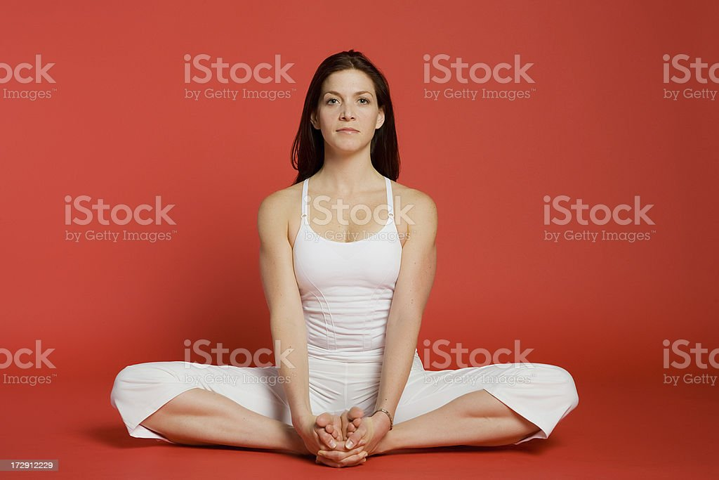 Woman sitting in Cobbler pose royalty-free stock photo