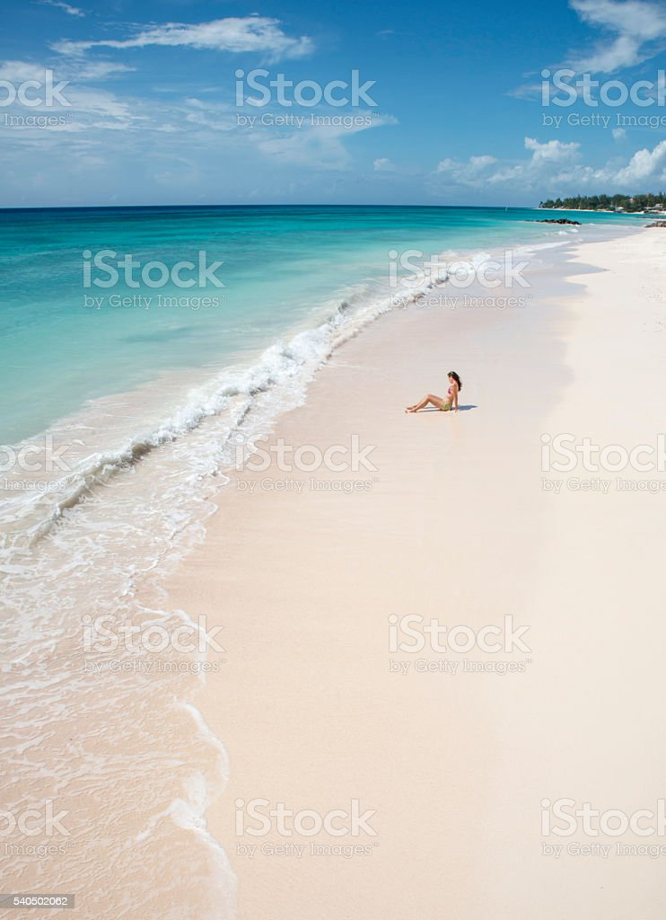 Woman sitting in front of the caribbean sea royalty-free stock photo