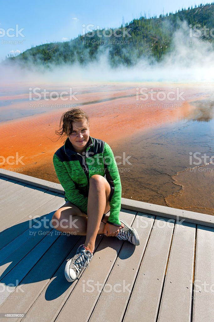 Woman Sitting in Grand Prismatic Springtm Yellowstone N.P ,Wyoming,USA stock photo
