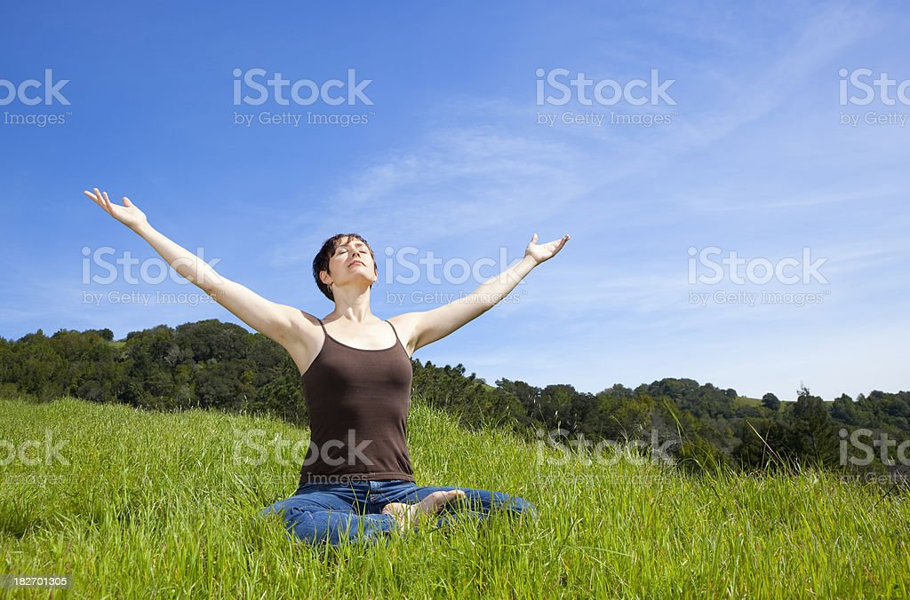woman sitting in meditation royalty-free stock photo