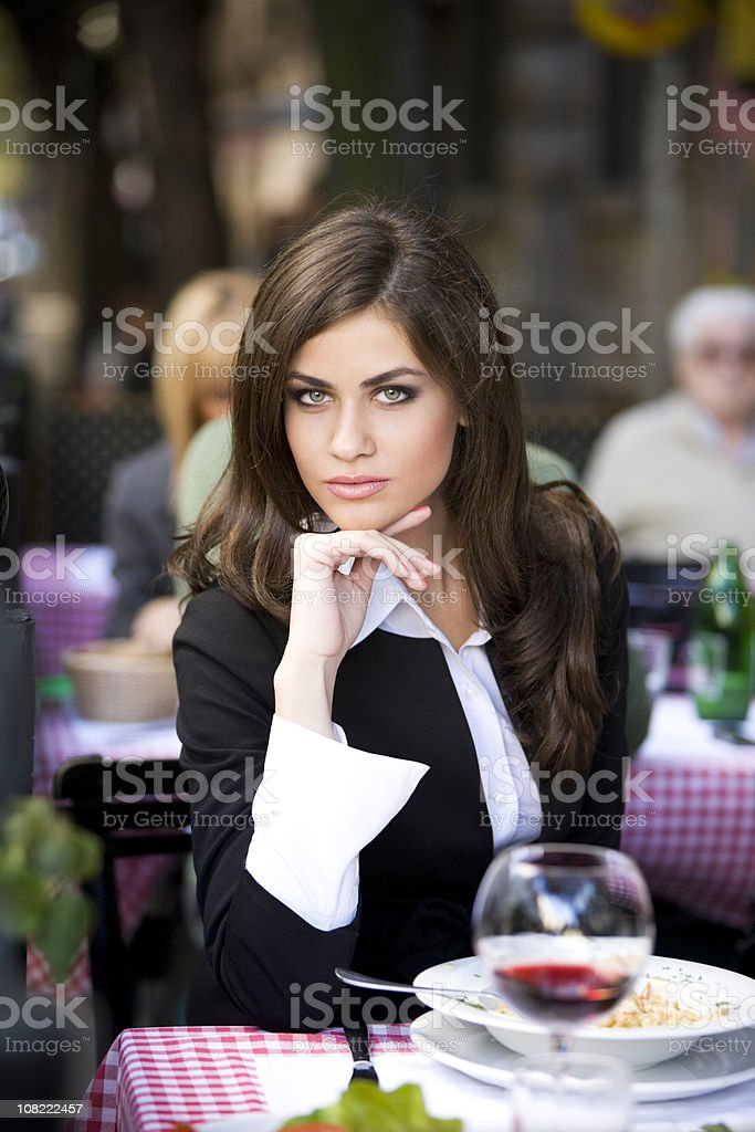 Woman sitting in outdoor cafe XXL royalty-free stock photo