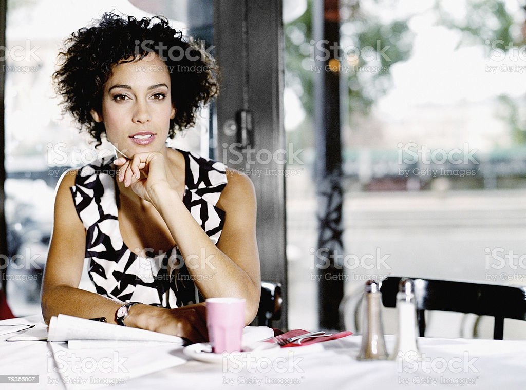 Woman sitting in restaurant with paperwork royalty-free stock photo