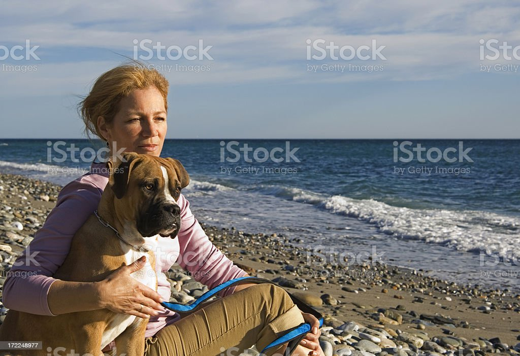 Woman sitting in the beach stock photo