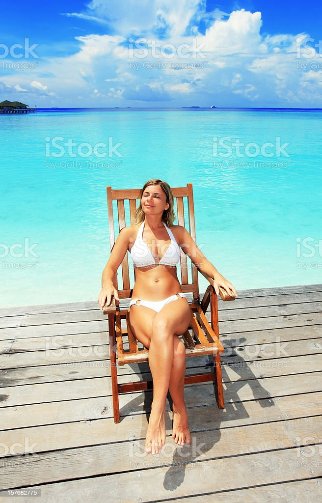 Woman sitting in the chair on a exotic resort royalty-free stock photo