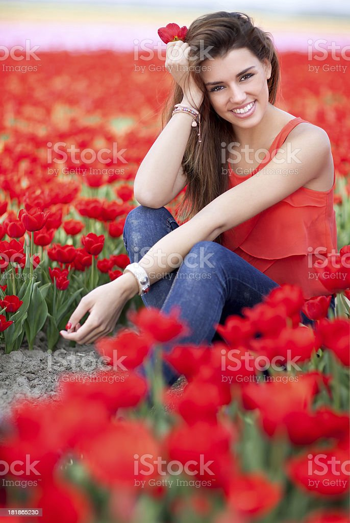 woman sitting in the middle of tulip field royalty-free stock photo