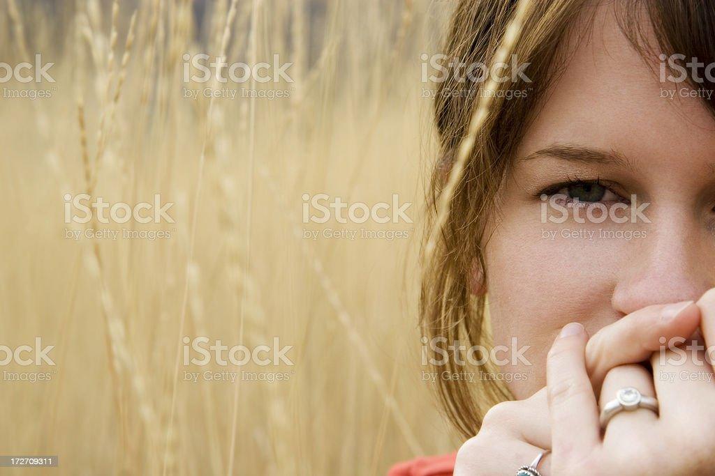Woman sitting in wheat field stock photo