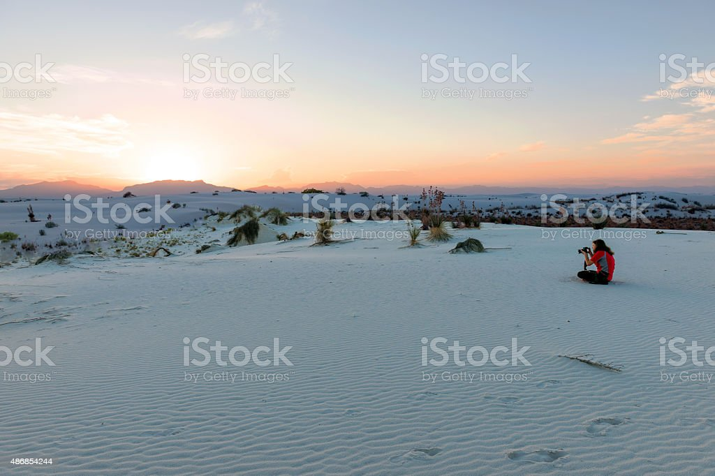 Woman Sitting in White Sands National Monument USA stock photo