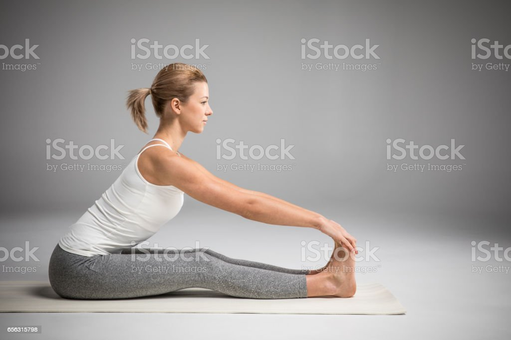 Woman sitting in yoga position stock photo