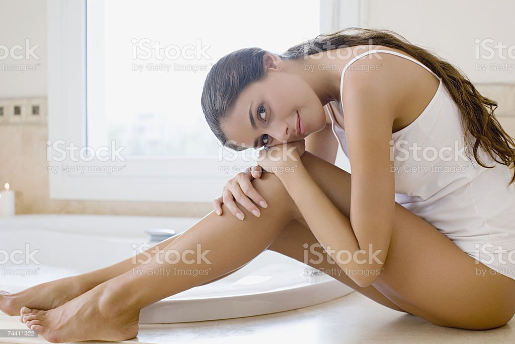Woman sitting next to bath royalty-free stock photo