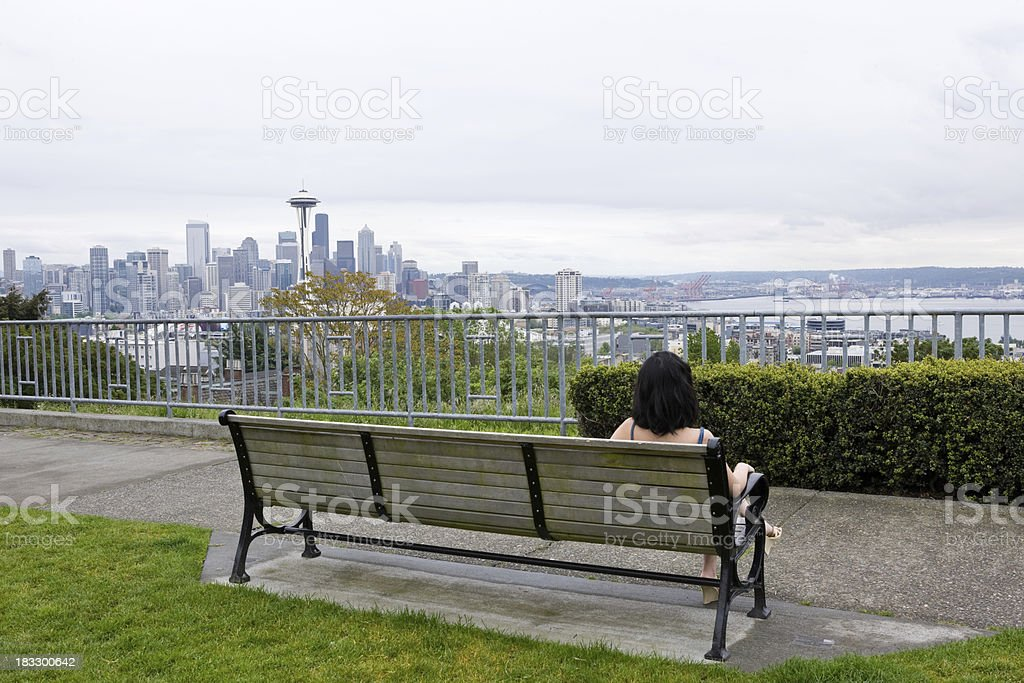Woman Sitting On A Bench In Seattle Park stock photo