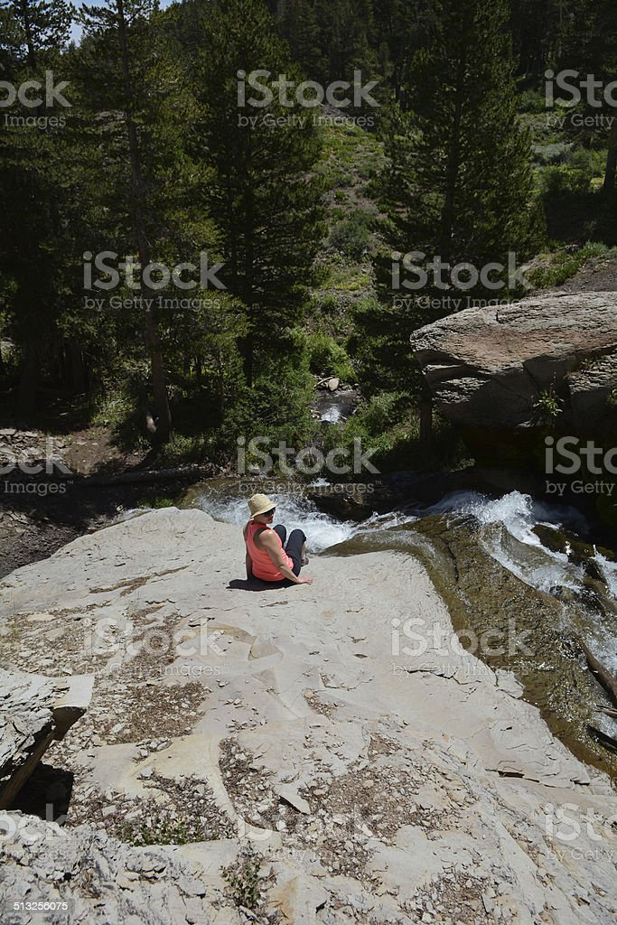 Woman Sitting on a Rock royalty-free stock photo