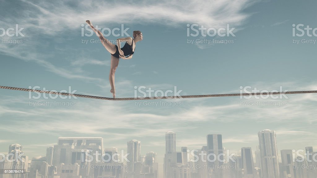 Woman sitting on a rope stock photo