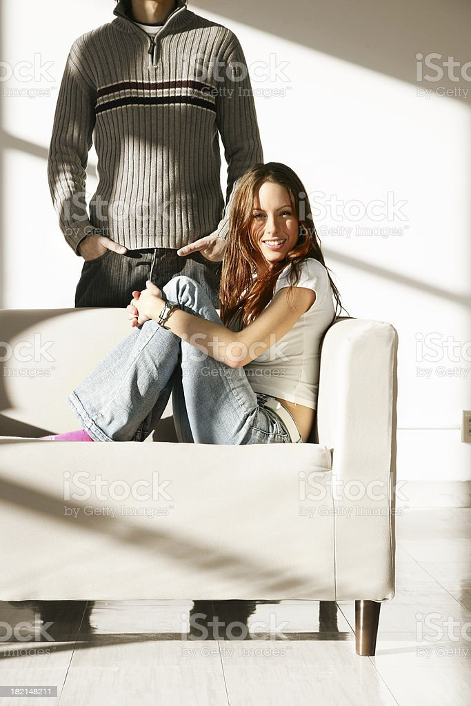 Woman sitting on a sofa royalty-free stock photo