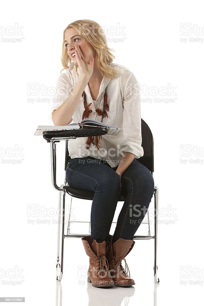 Woman sitting on a writing chair stock photo