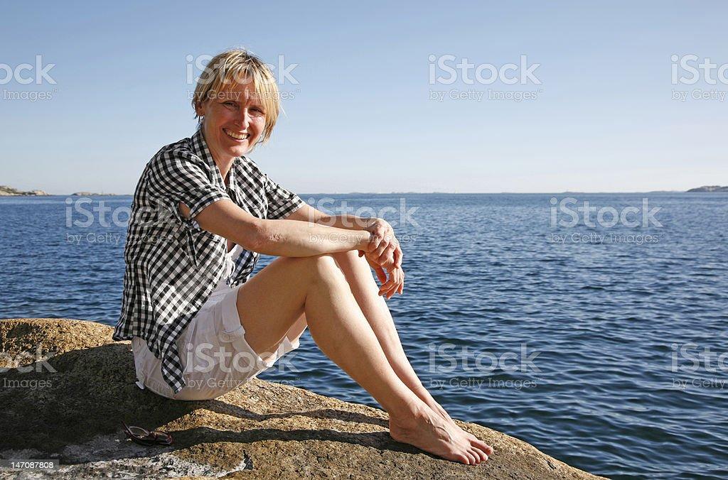 Woman sitting on an island royalty-free stock photo