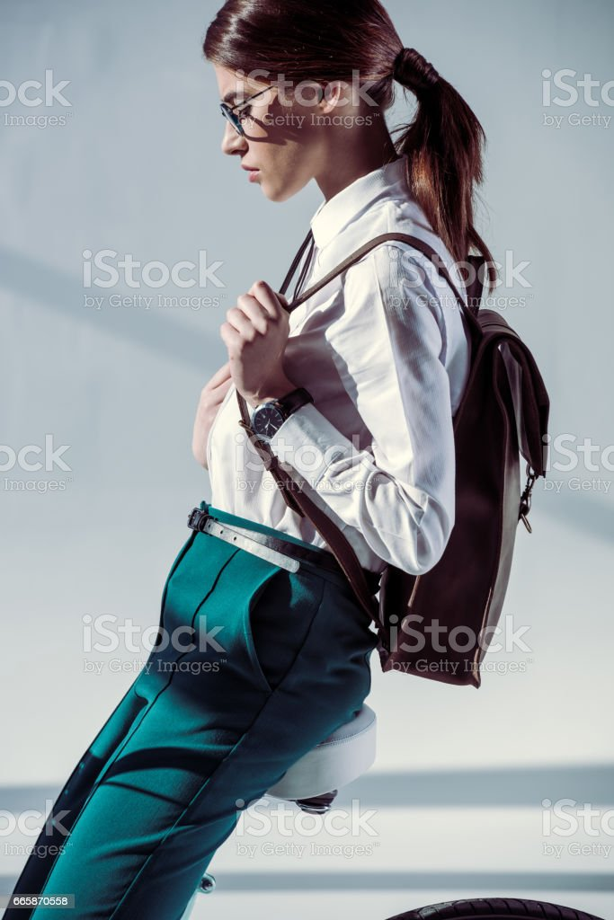 woman sitting on bicycle stock photo